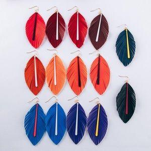 Faux leather leaf earrings.